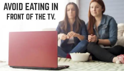AVOID EATING IN FRONT OF YOUR TV